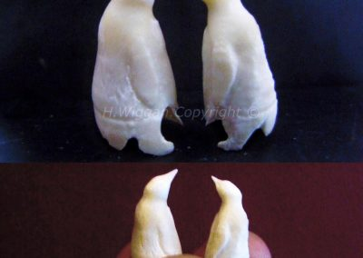 Penguin sculptures created from dolphin teeth found on beach- Hedley Wiggan